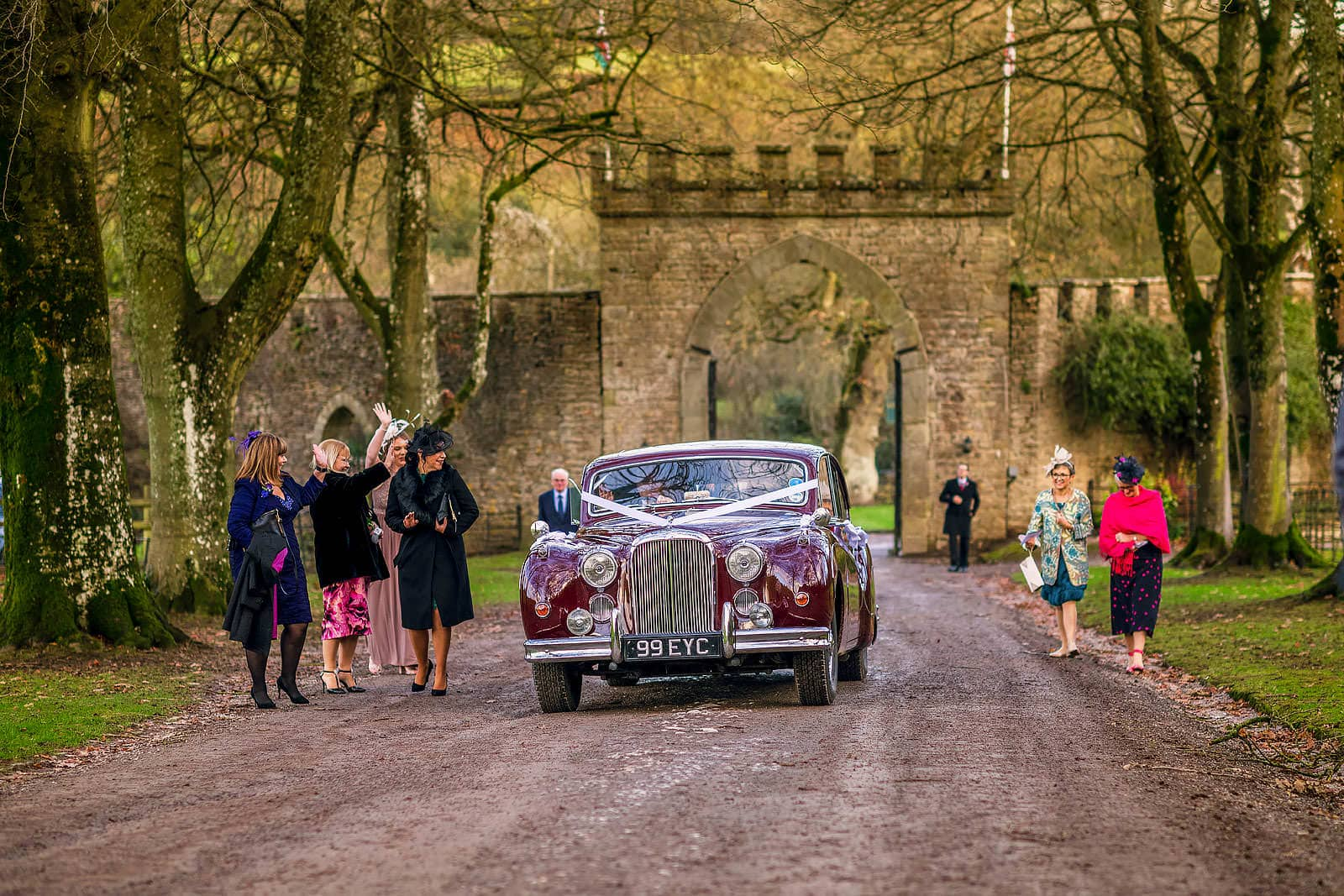 The brdal enters Clearwell Castle in the car