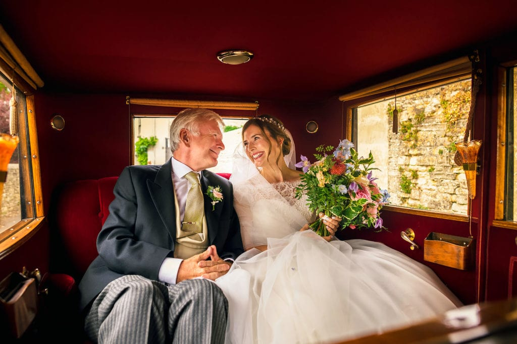 Father of the groom and his daughter during their Cotswolds wedding