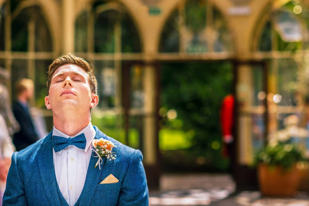Nervous groom waiting for his wife to be