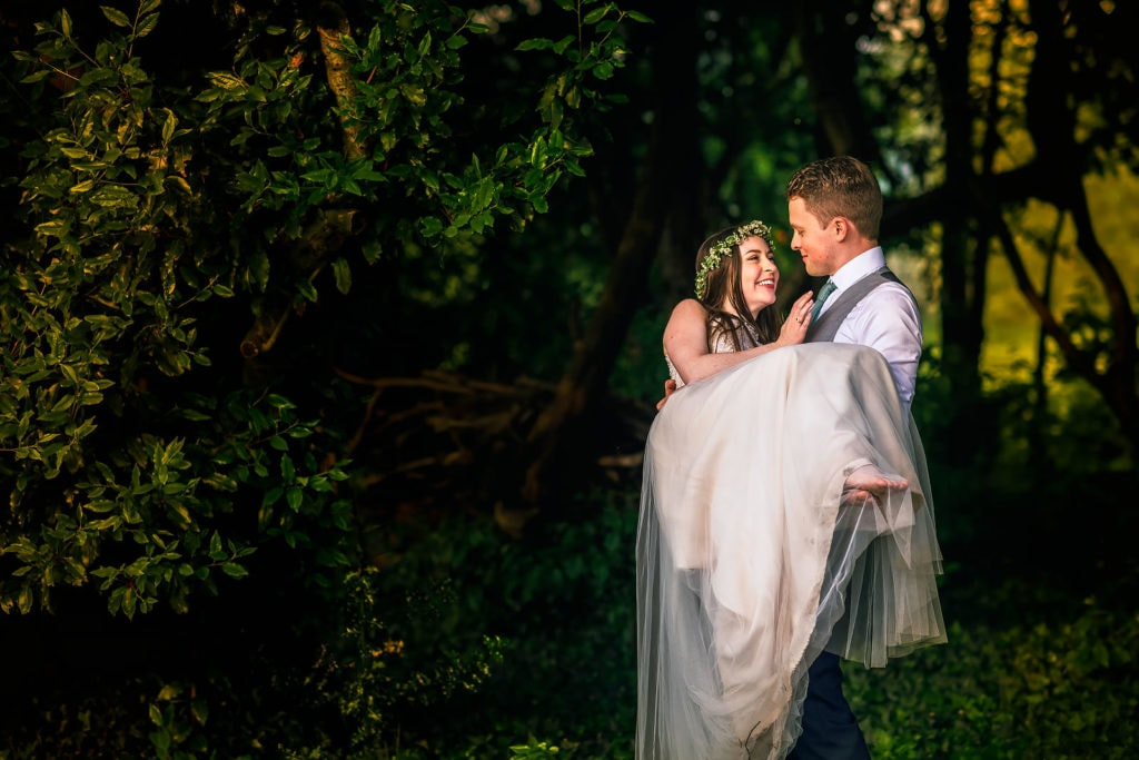 Newly weds sharing a lovely moment at their Cotswolds wedding