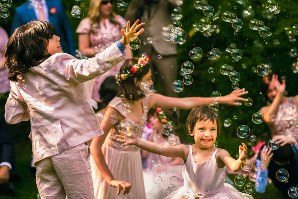 The young ones having lots of fun with bubbles at a Cripps Barn wedding