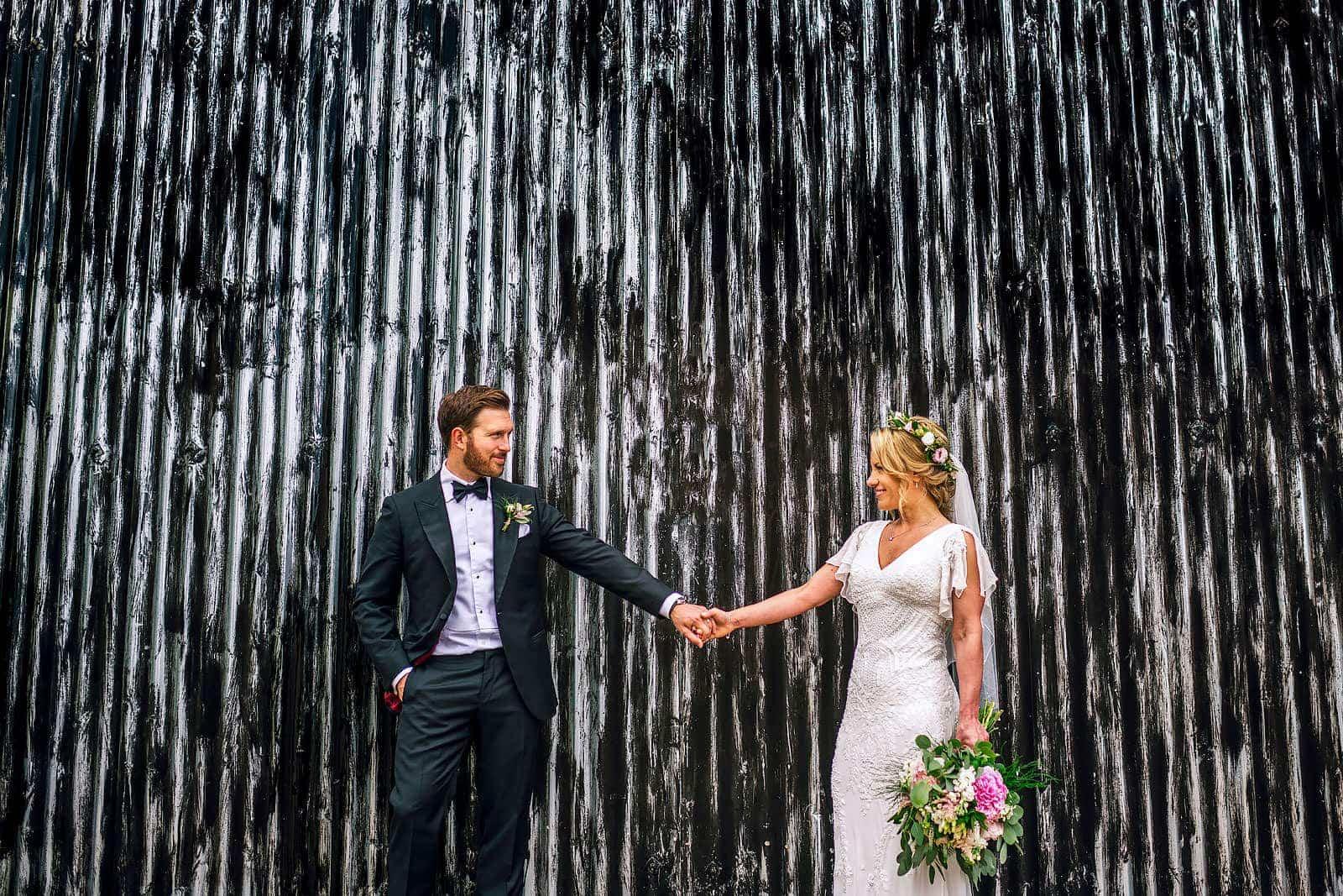 Newlyweds enjoying their barn wedding