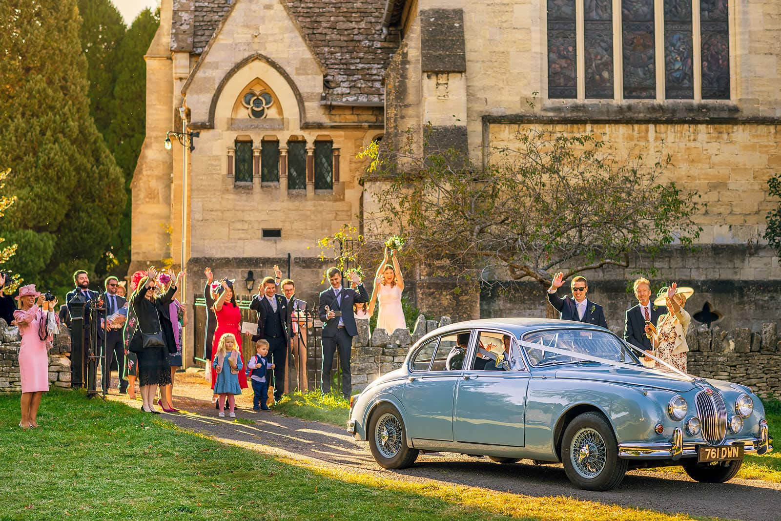 Waving the bride and groom off from the church