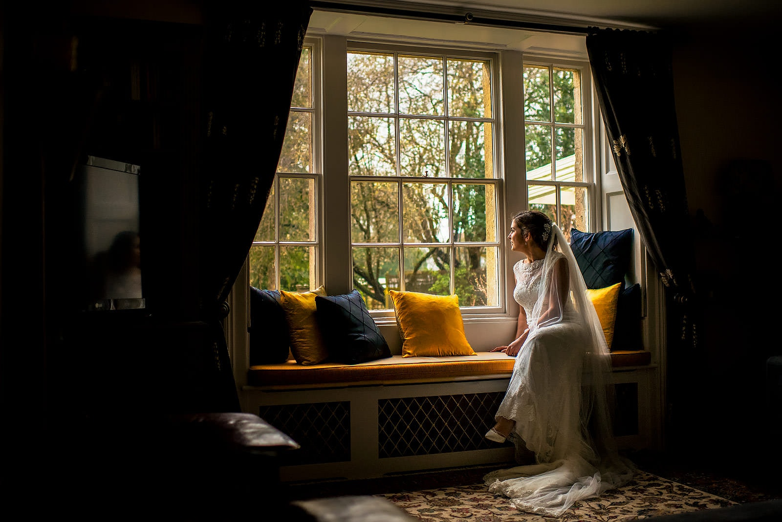 The bride peering through the window