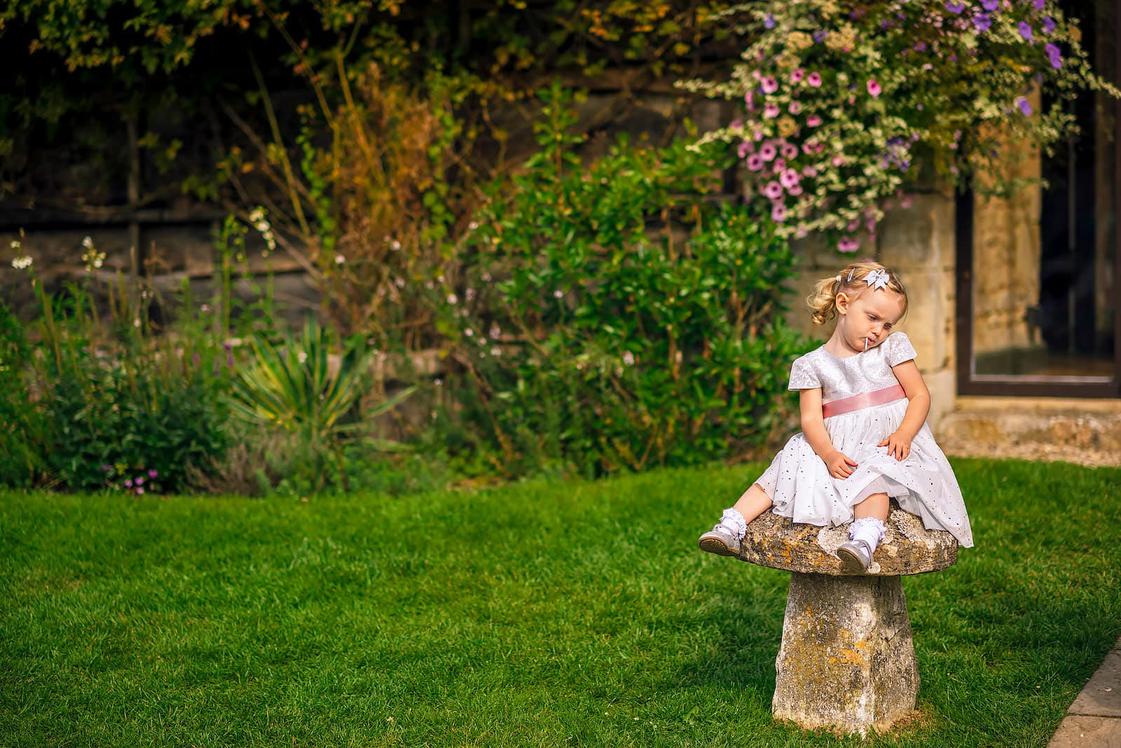 Flower girl enjoying the wedding