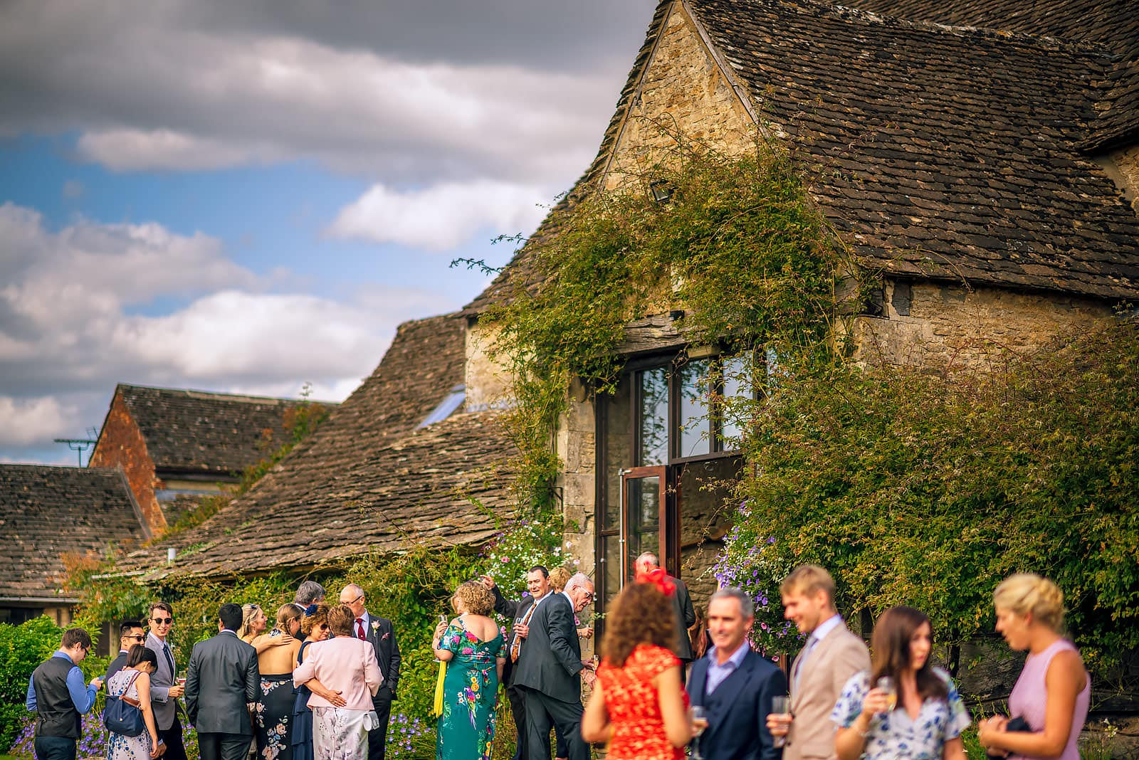 Guests mingling at The Great Tythe Barn