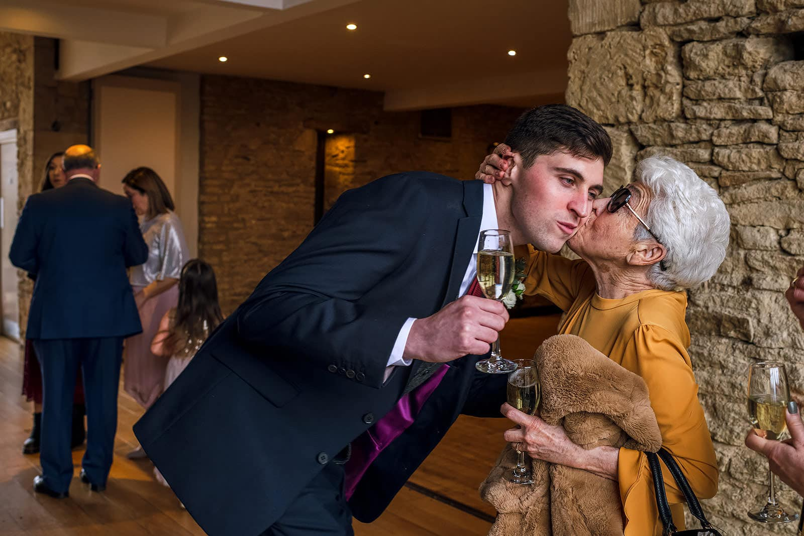 Groom kissing his nan atThe Great Tythe Barn