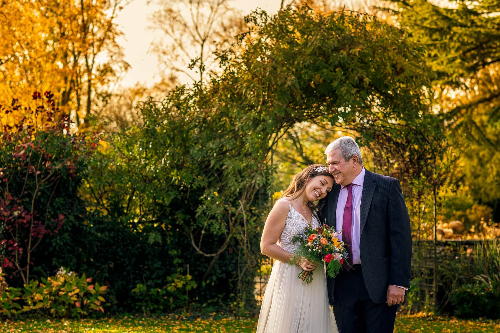Father of the bride sharing a moment with his daughter