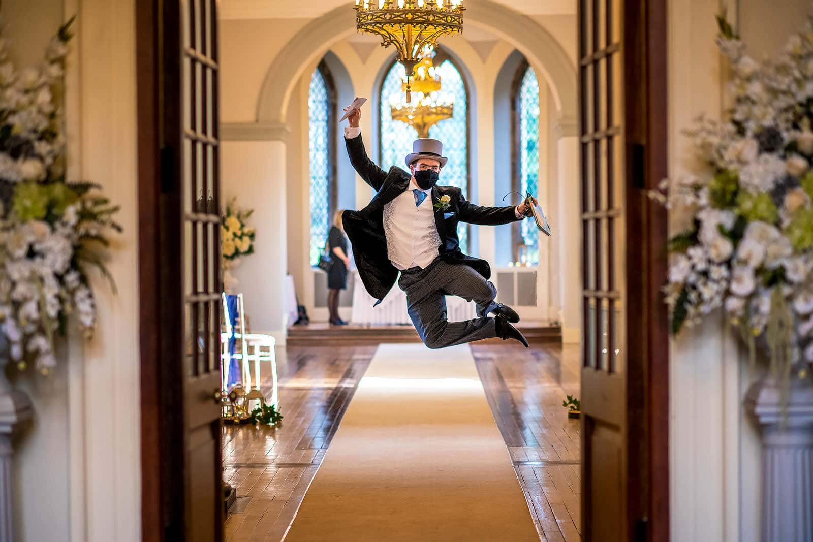 Groom jumps for joy at his wedding