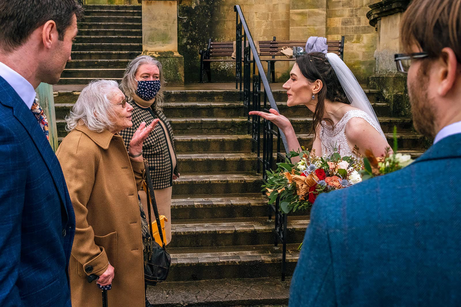 Bride and grandmother blow each other a kiss