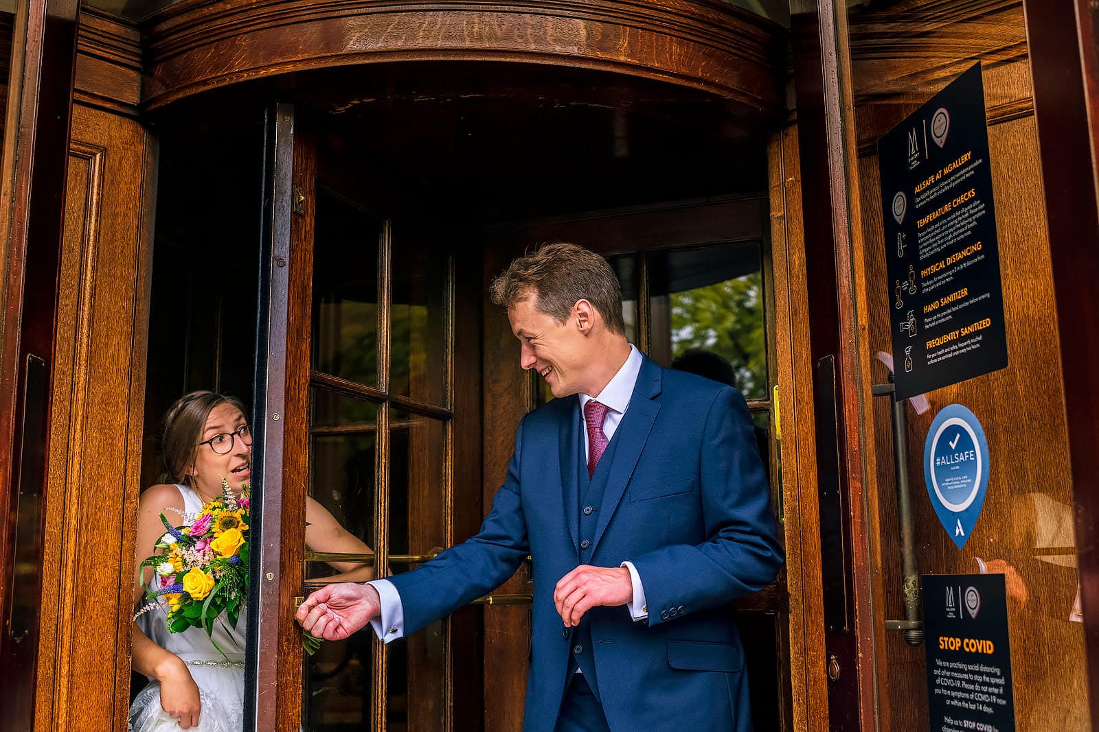 Groom forgets to let his wife through the door