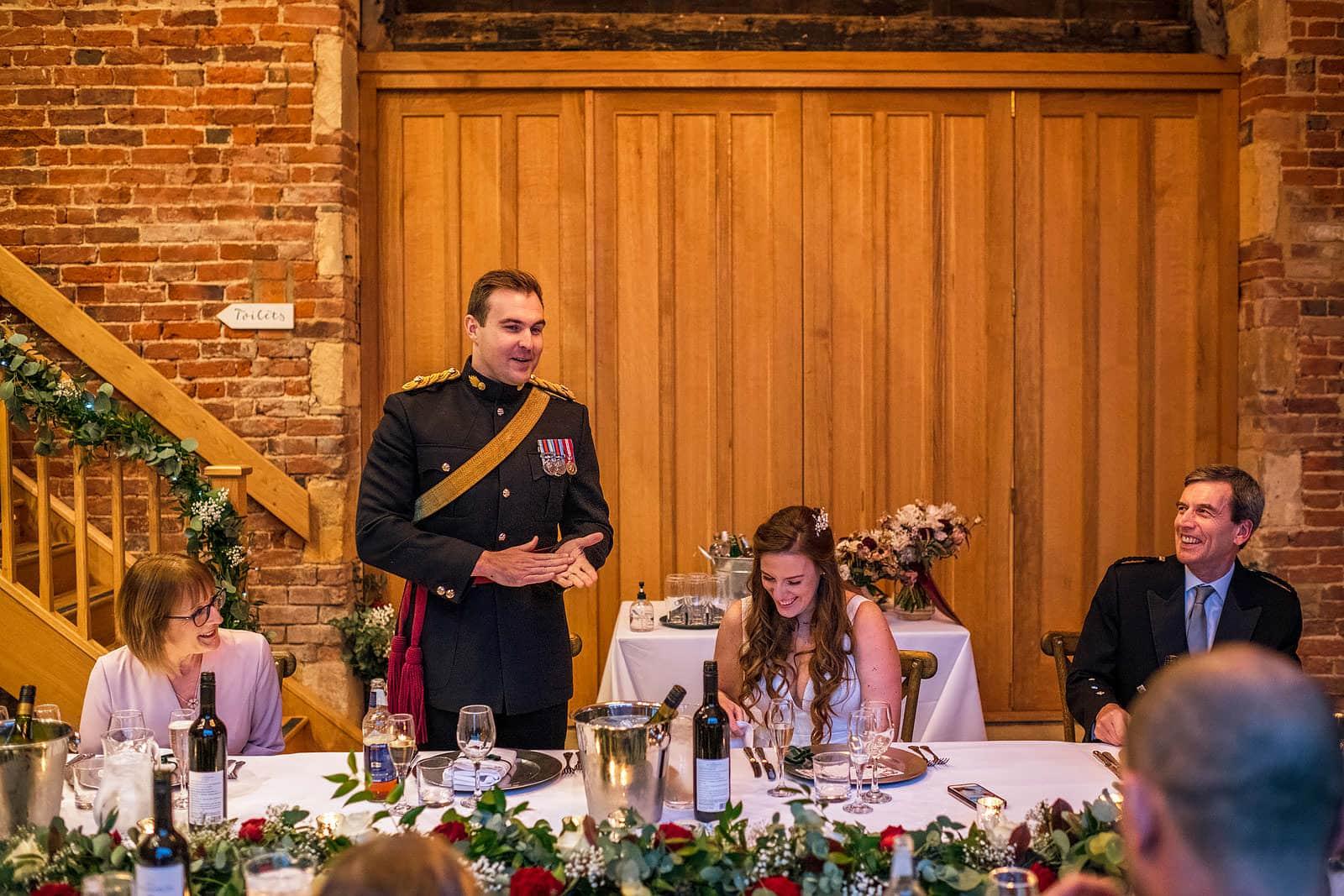 Groom in uniform giving his speech
