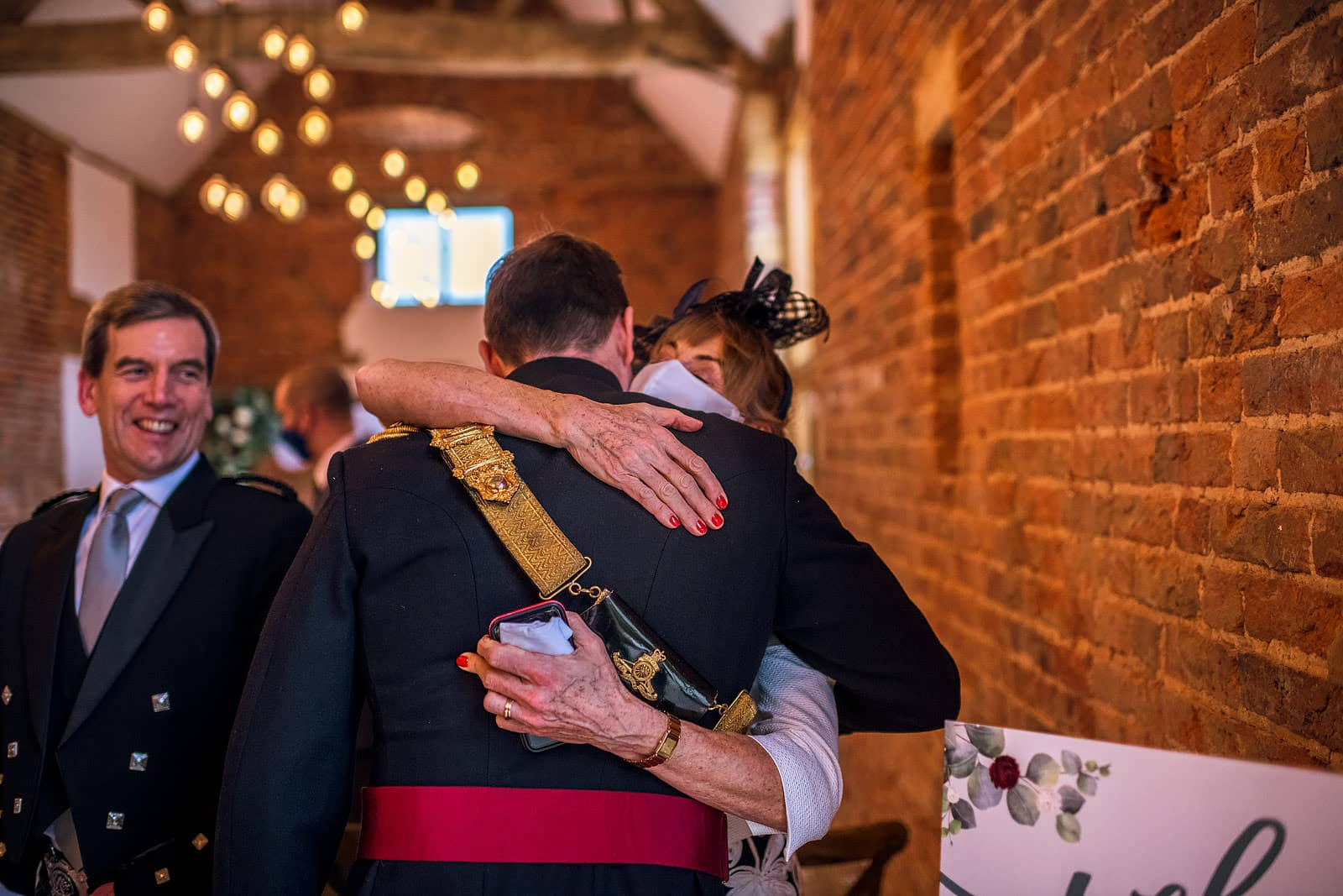 Guest giving groom a hug