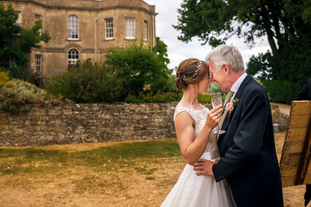 Father and bride enjoy a special moment at Hamswell House