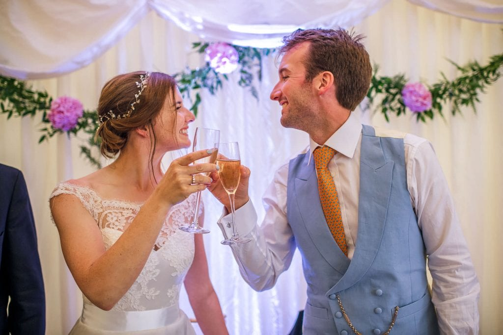 Bride and groom share a drink