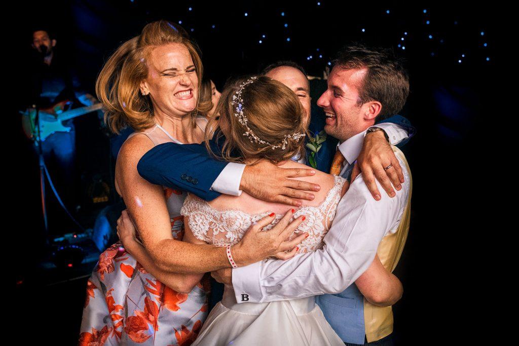 Joyous wedding guests dancing
