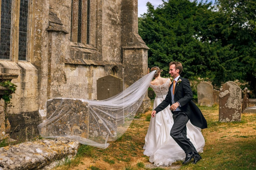 Bride catches her veil at the church