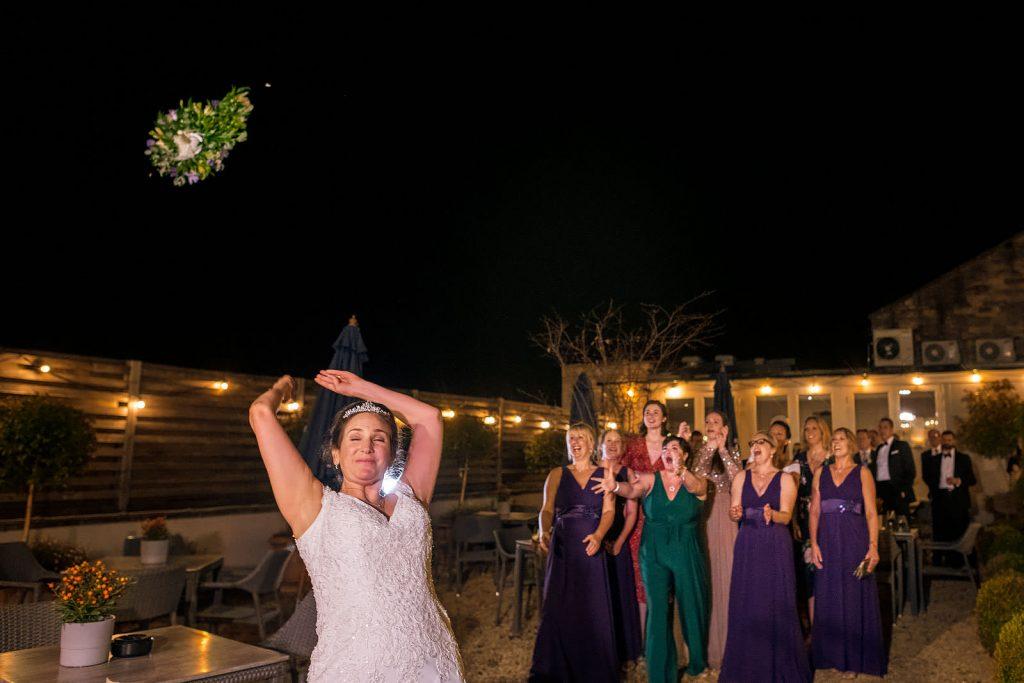 Bride bouquet toss at teh Kings Head Hotel