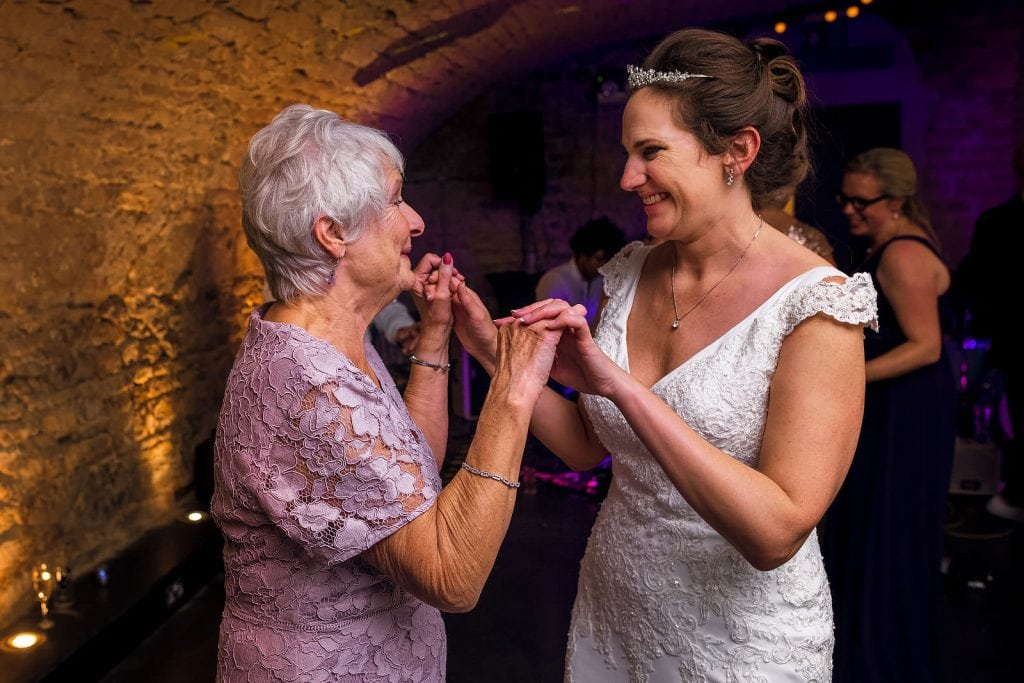 Mother and daughter dancing at the wedding