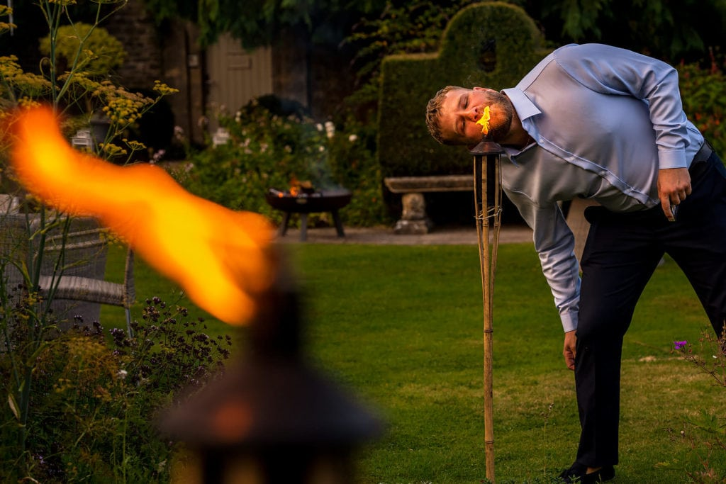 Wedding guest lighting his cigarette at Barnsley House