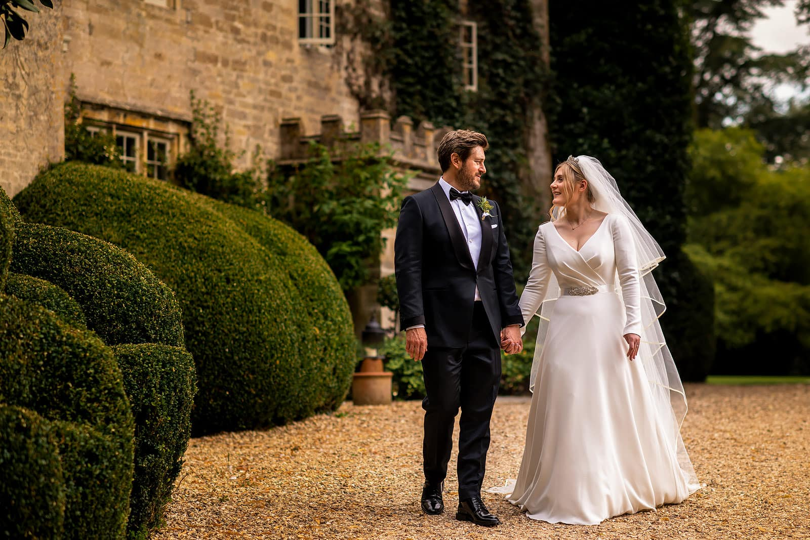 Bride and groom walking together at Barnsley House